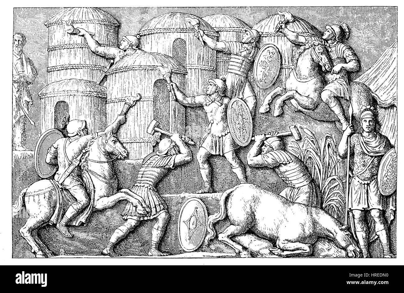 Destruction of the huts in a abandoned village, before the enemies arrived, from a relief on the victory collumn - Stock Image