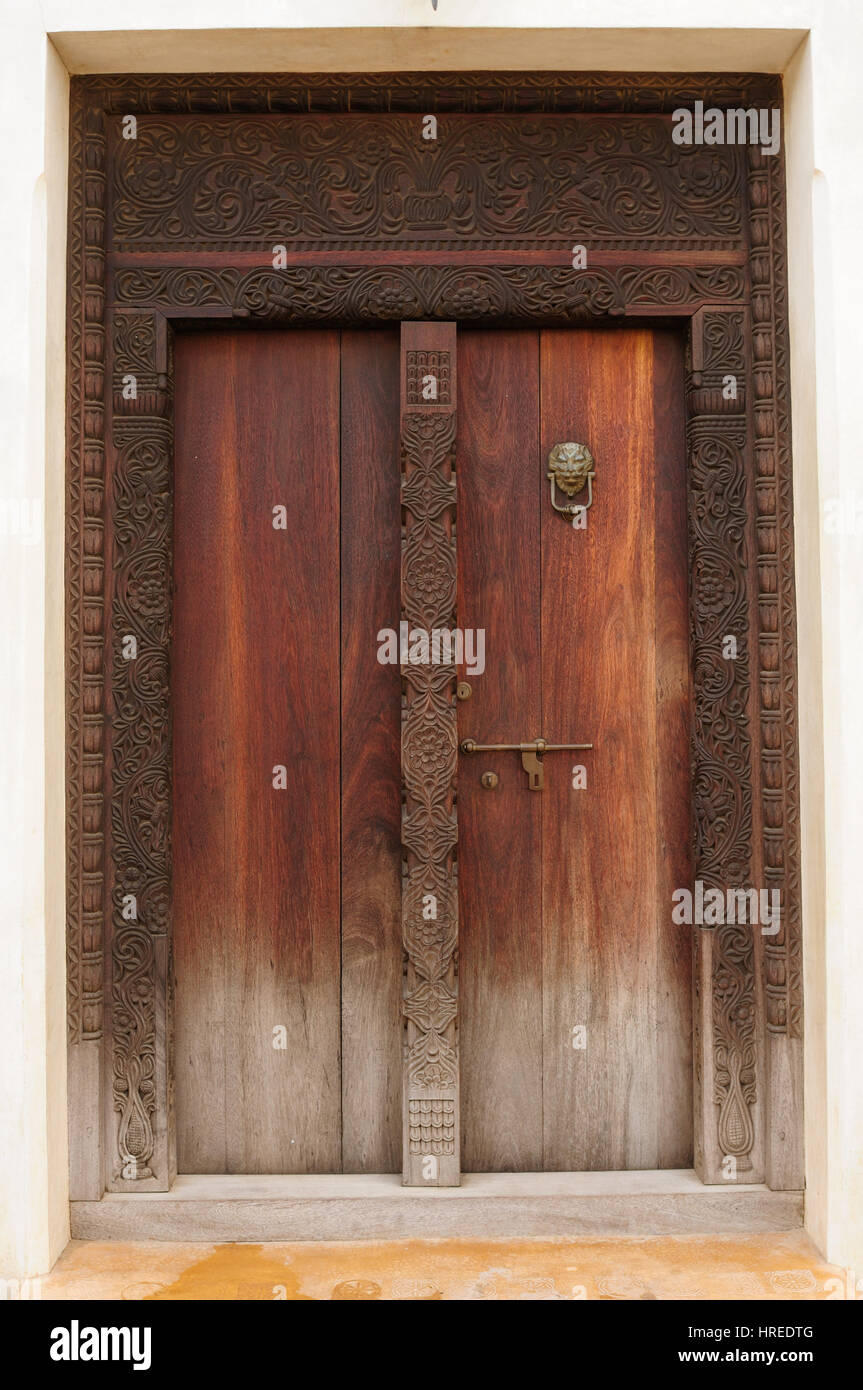 Traditional carved wooden door in Lamu Town, Kenya Stock Photo