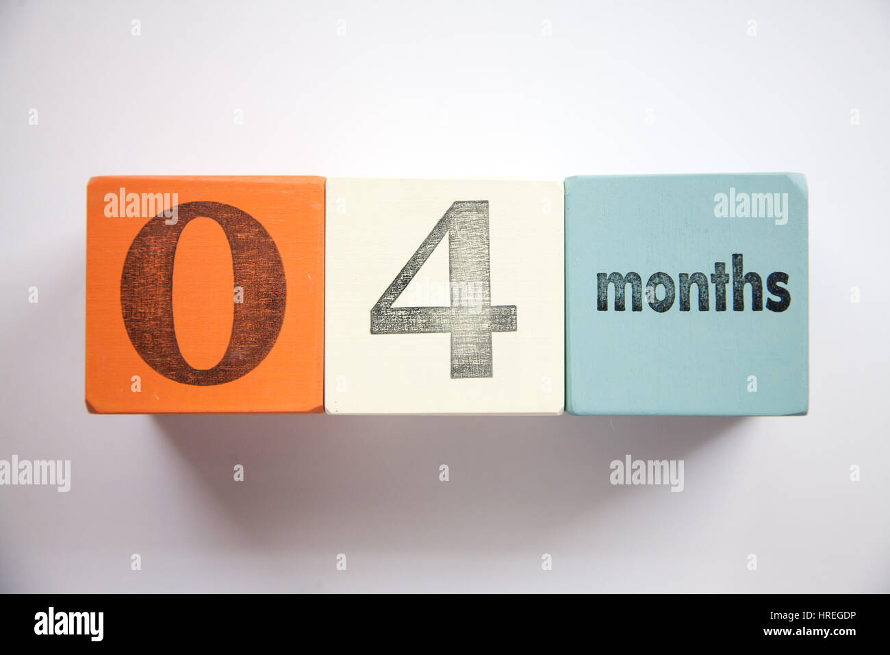 Baby blocks four months age - Stock Image