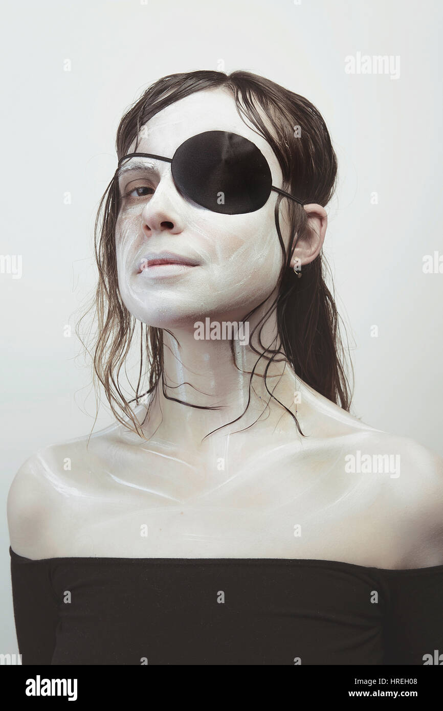 Woman with an eye patch and white skin - Stock Image