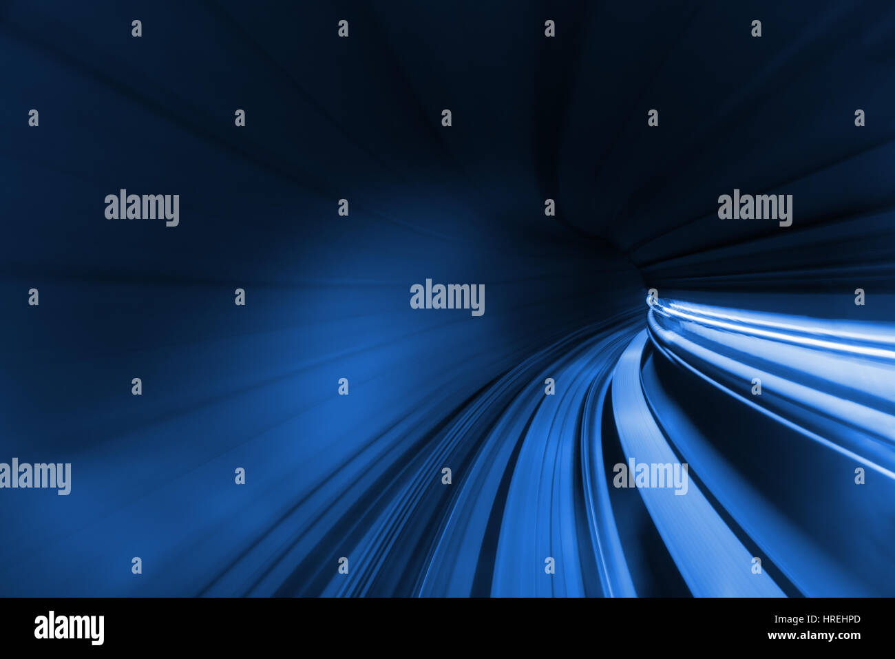 Speed blurred motion of train or subway train moving inside tunnel. - Stock Image