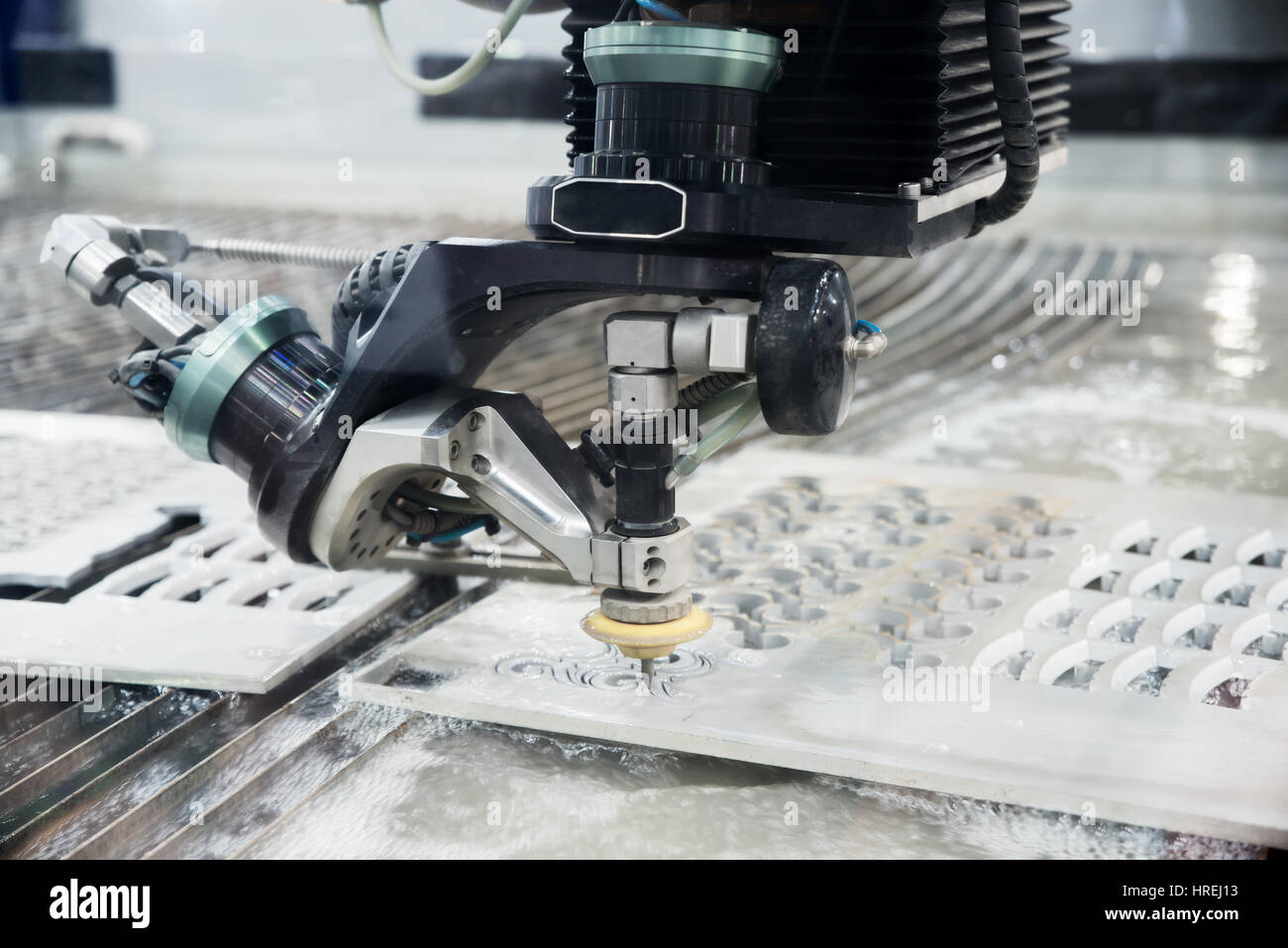 Operator use EDM electrod to make precision mold and die in factory. - Stock Image