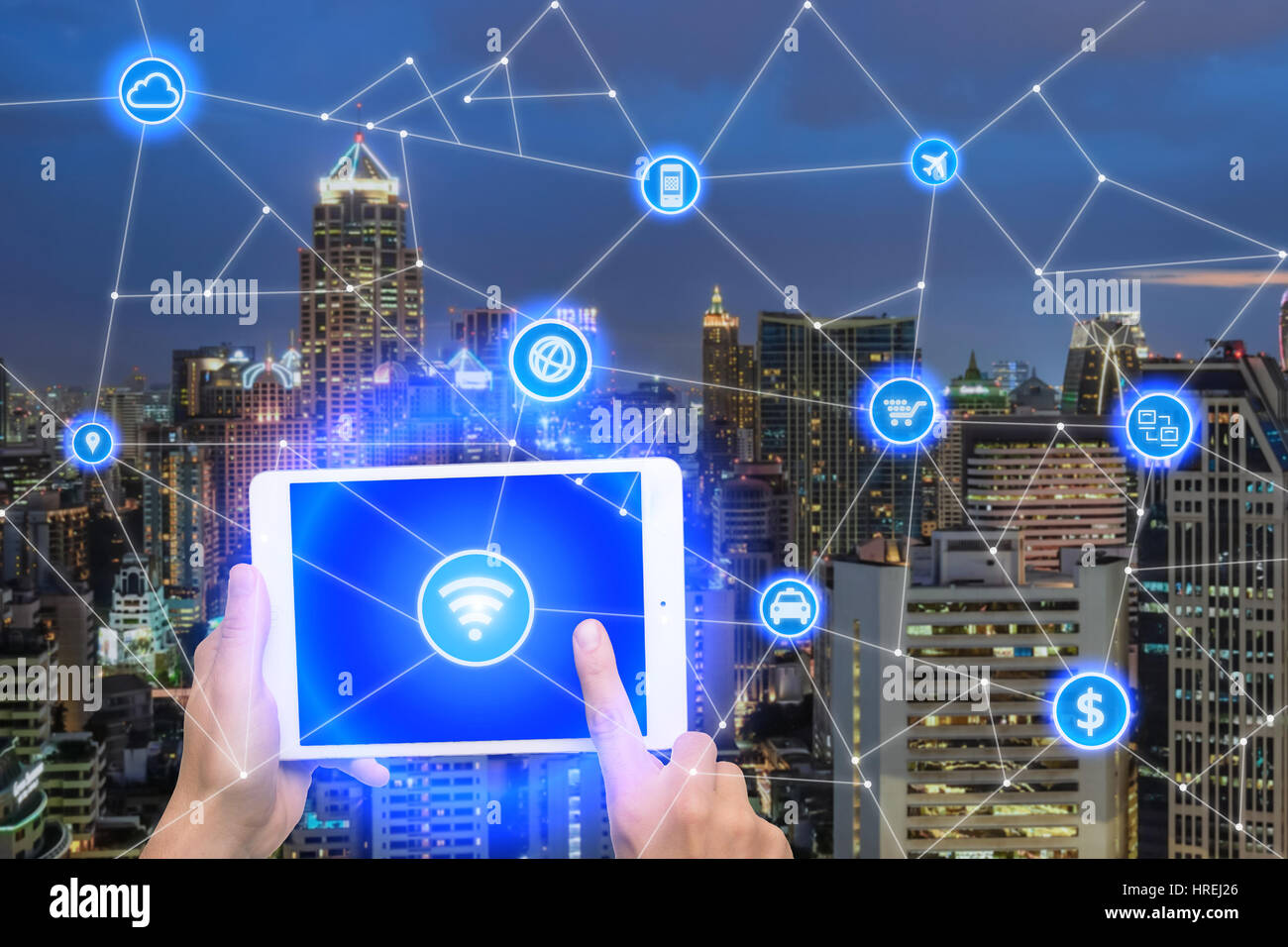 Network of connect digital tablet with wireless communication network, business district with office building, abstract - Stock Image