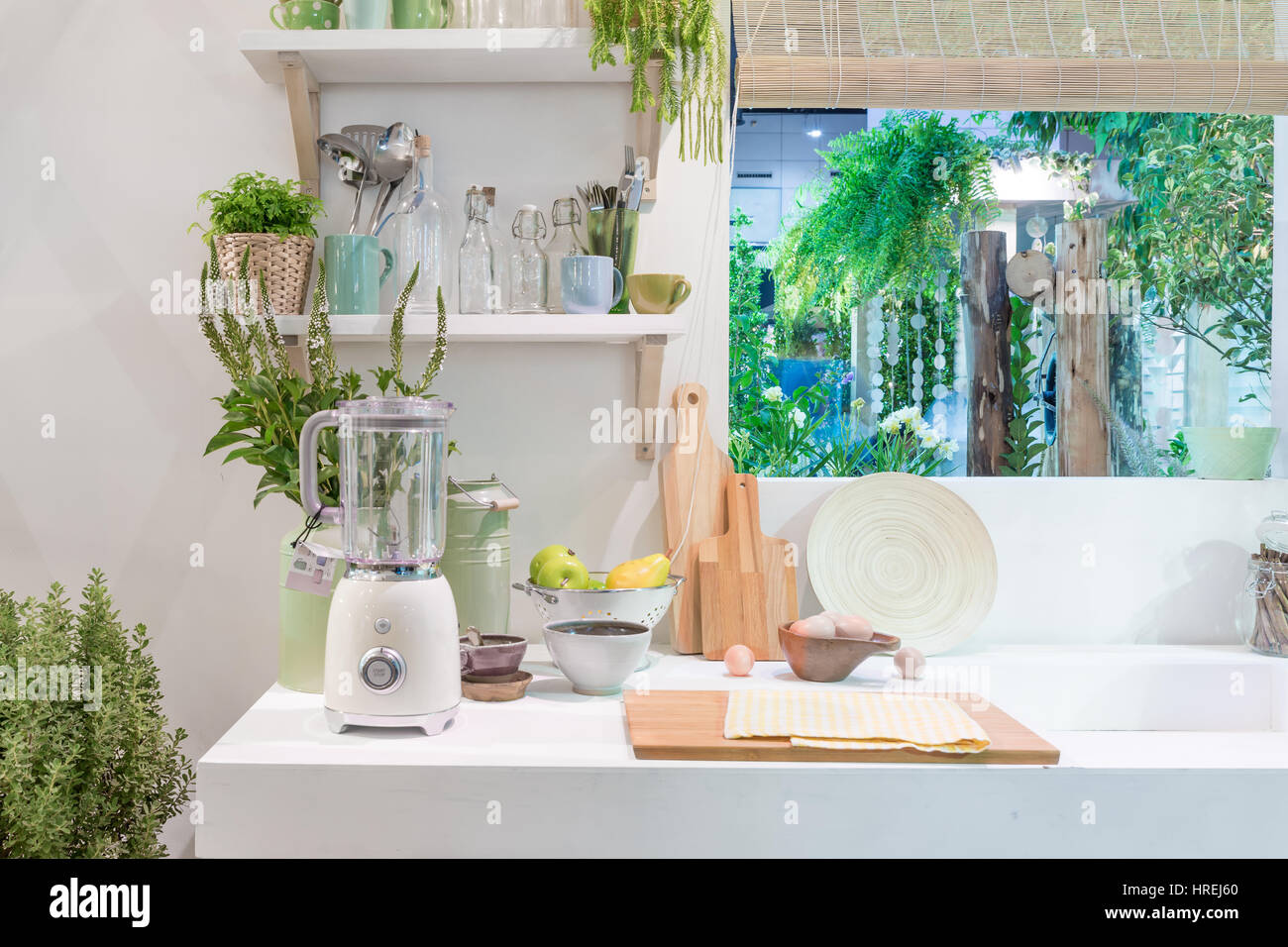 Interior of modern kitchen with blender, block, knife and kitchen appliance in house. - Stock Image