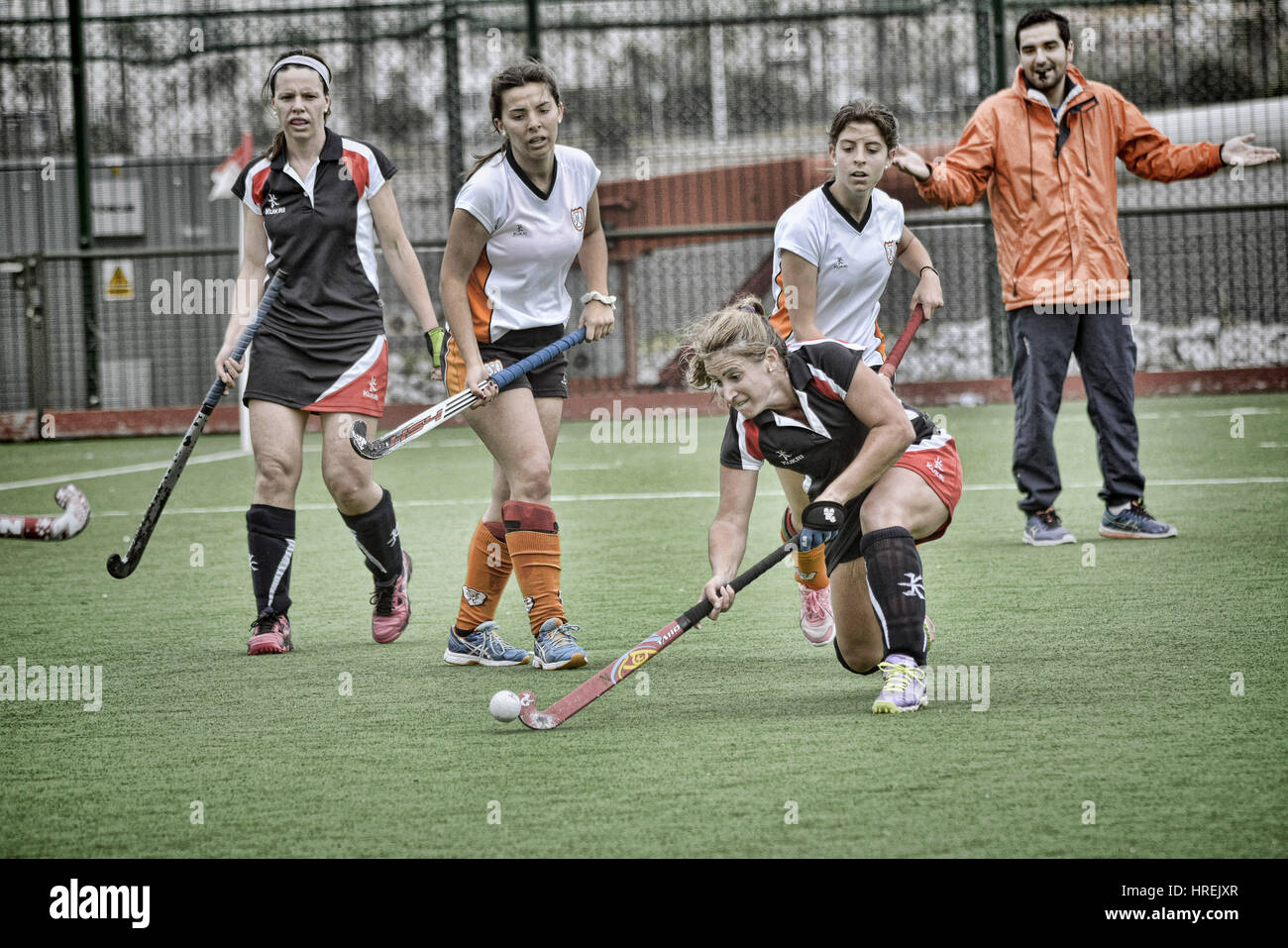 Gibraltar Hockey - Grammarians HC playing friendly against San Fernando HC from Cadiz. - Stock Image