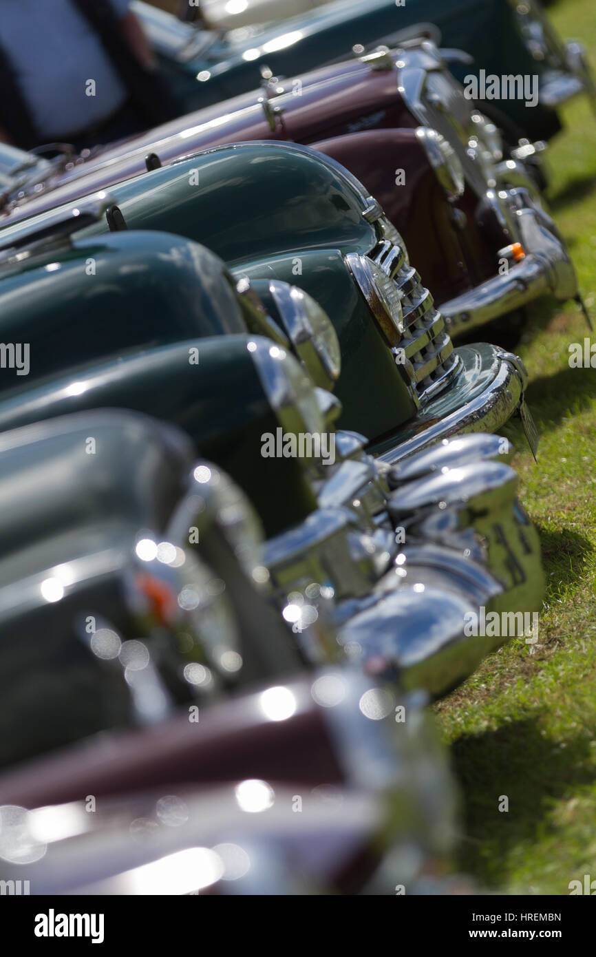 Row of highly polished vintage cars - abstract diagonal close-up - Stock Image