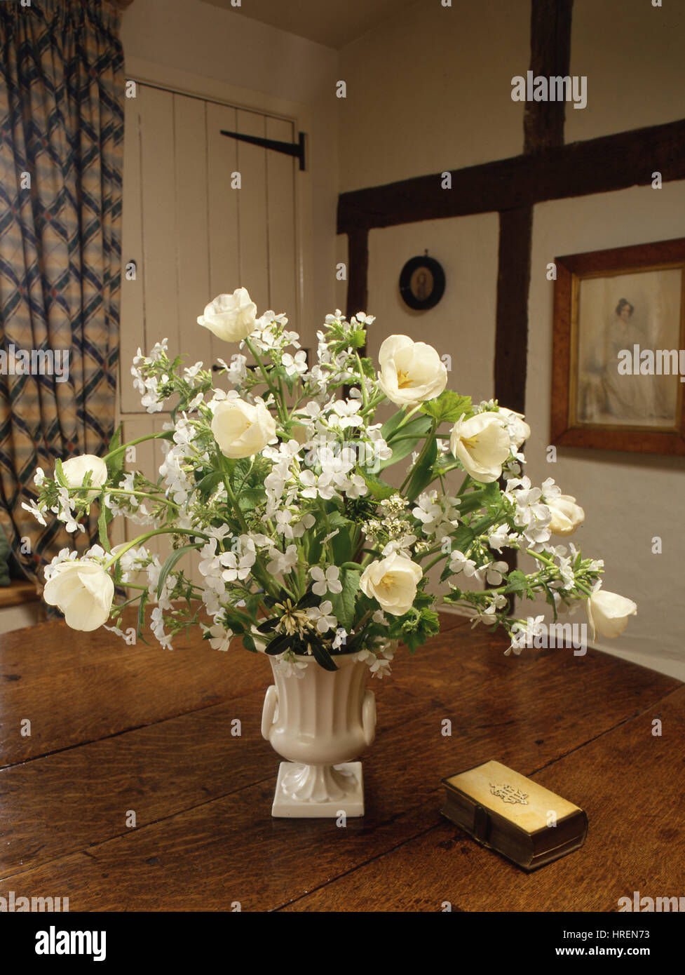 All White Flower Arrangement In A English Cottage Setting Stock