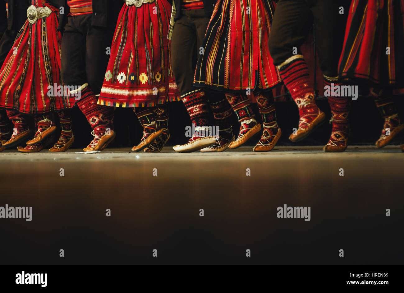 Abstract composition showing legs dressed in Serbian traditional clothe dancing in folklore. - Stock Image