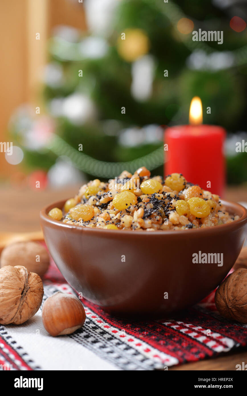 Traditional Christmas slavic dish kutia in ceramic bowl with fir tree - Stock Image