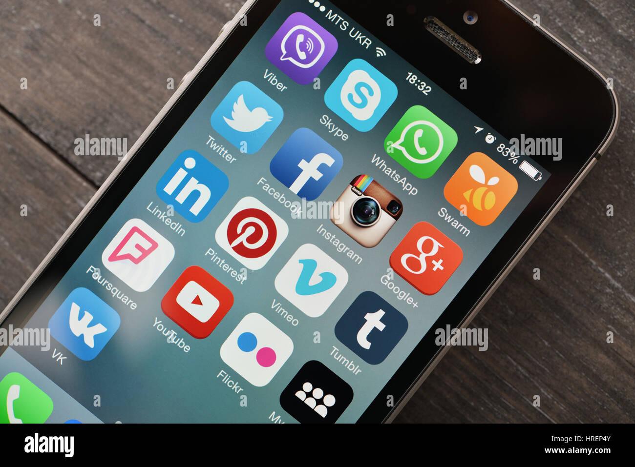 KIEV, UKRAINE - JANUARY 29, 2015: Social media icons on screen of smartphone . Social media are most popular tool - Stock Image