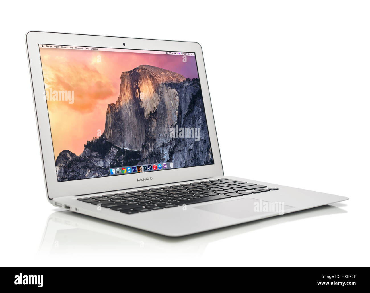 KIEV, UKRAINE - JANUARY 29, 2015: Studio shot of brand new Apple MacBook Air Early 2014 with home page on screen, - Stock Image