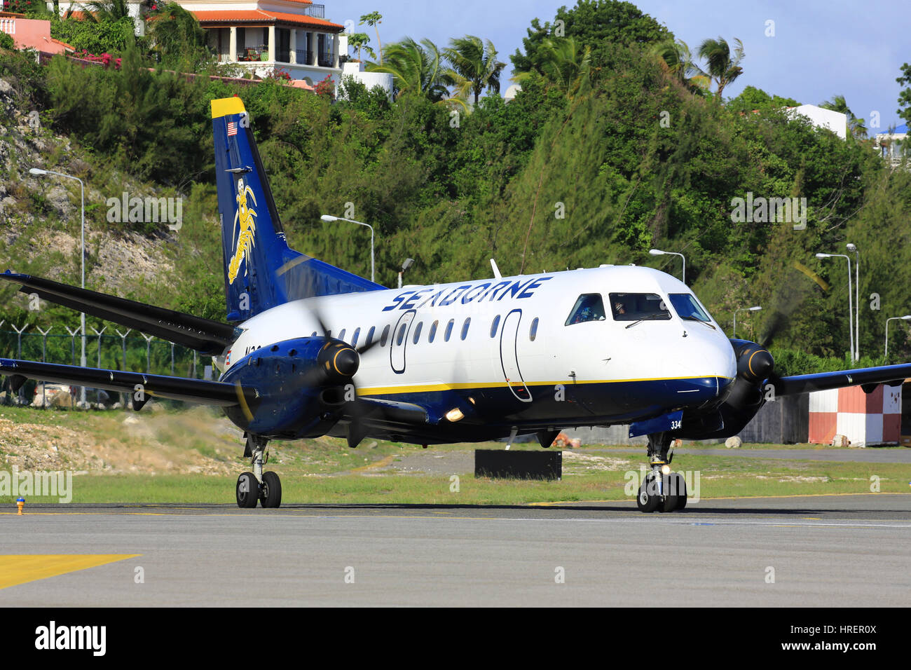 A Seaborne Airlines Saab SF.340 prepares to depart St. Maarten back to its operating base in San Juan, Puerto Rico. - Stock Image