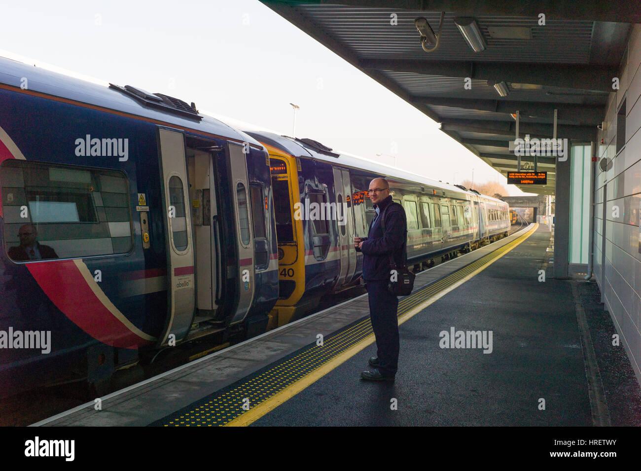 Train and guard at Edinburgh Gateway Tram / Train Station interchange for Edinburgh Airport Stock Photo
