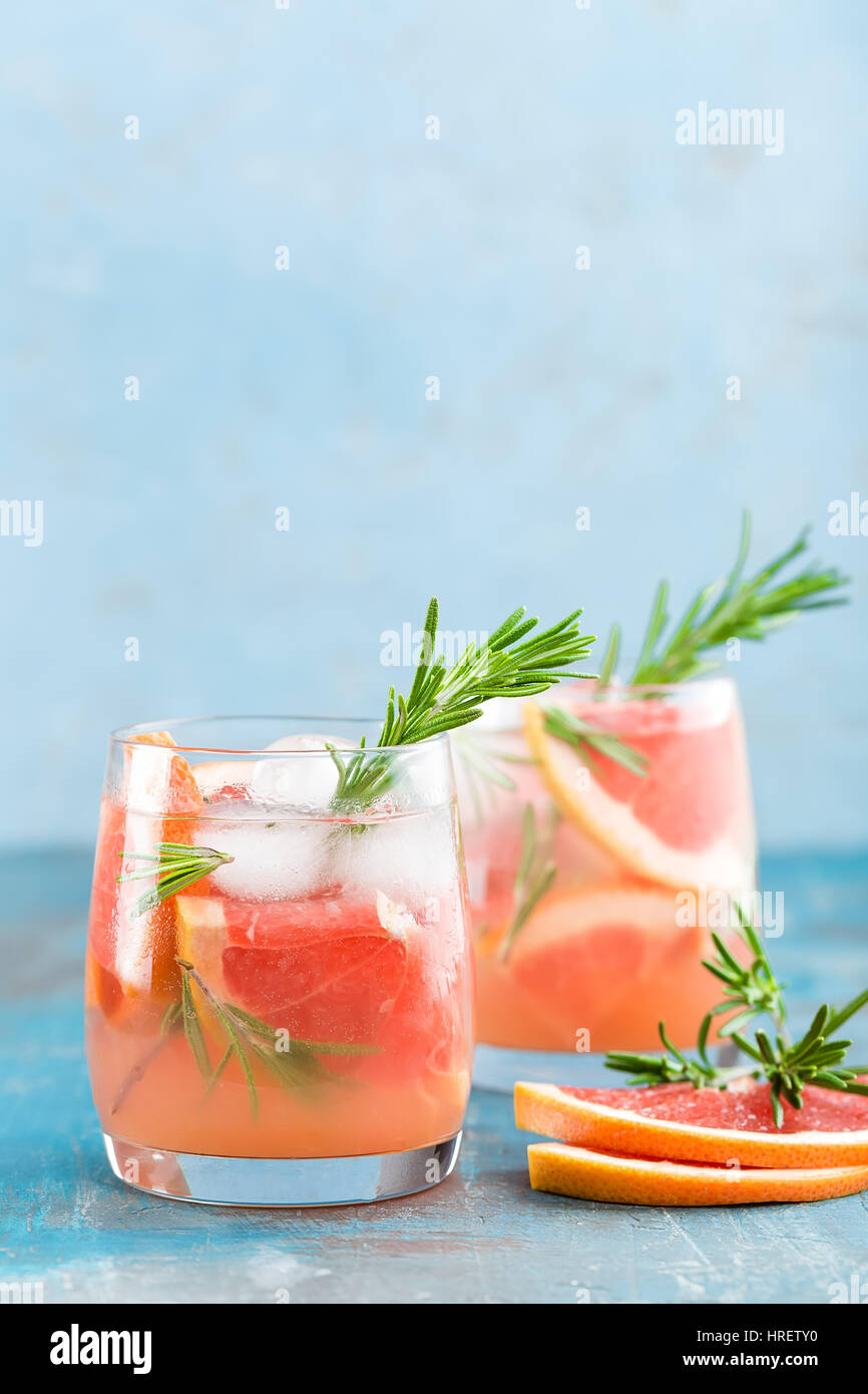 Grapefruit and rosemary gin cocktail, refreshing drink with ice - Stock Image