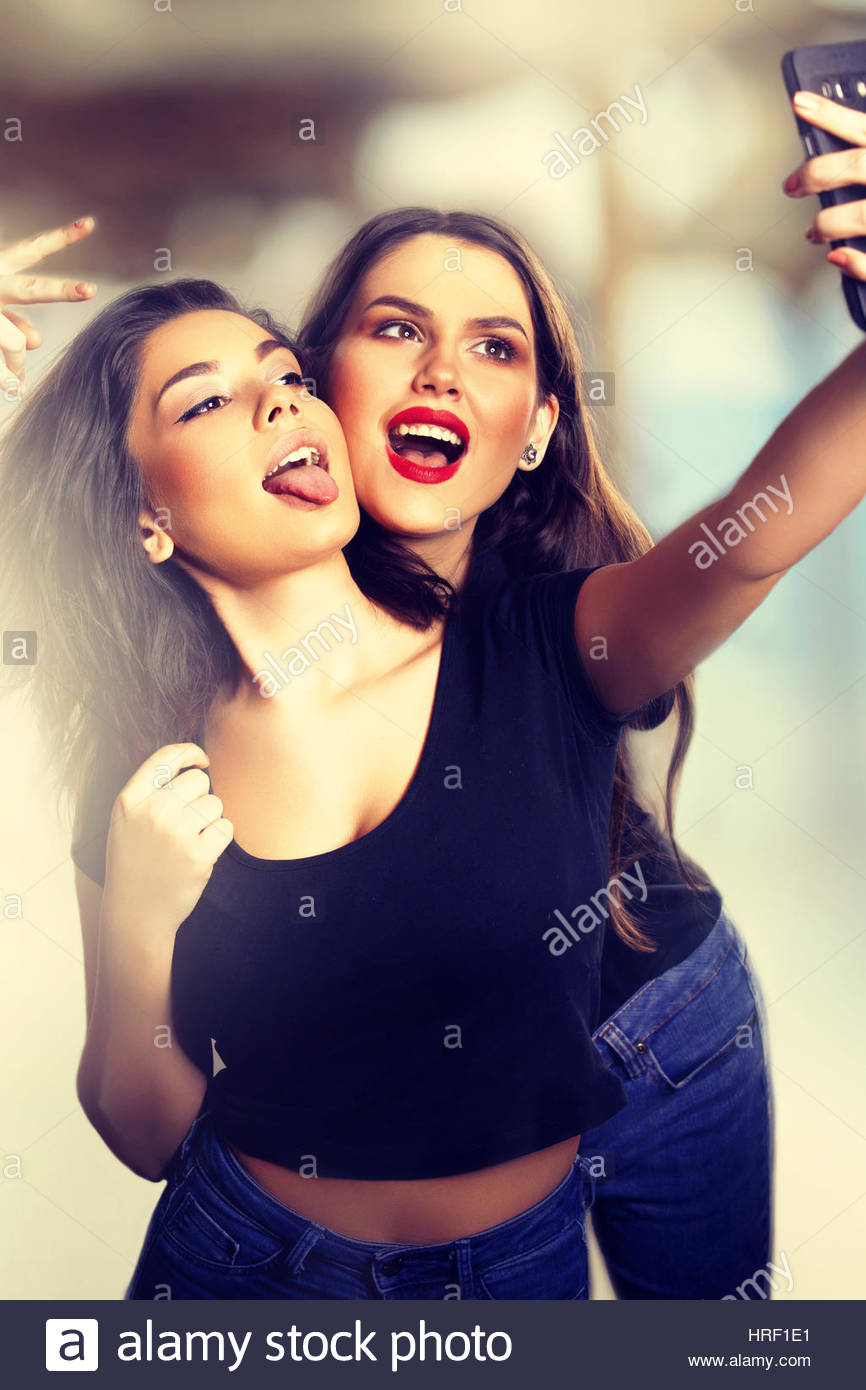 Funny Teens Taking a Selfie in the Summer. Stock Photo