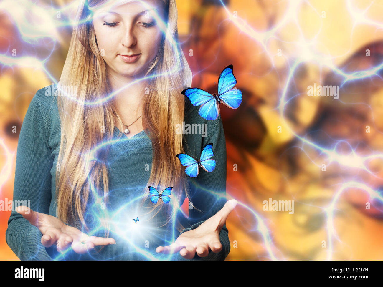 girl with open hands and butterflies flying around, imagination and creativity concept - Stock Image