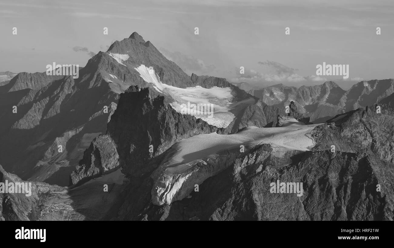 Mountain peaks and glacier in Switzerland, view from mount Titlis. - Stock Photo