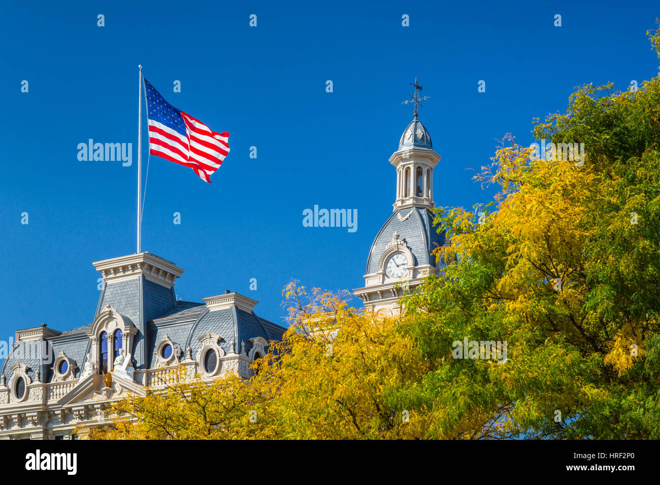 The American flag flying above the Wayne County Courthouse in Wooster, Ohio, USA. - Stock Image