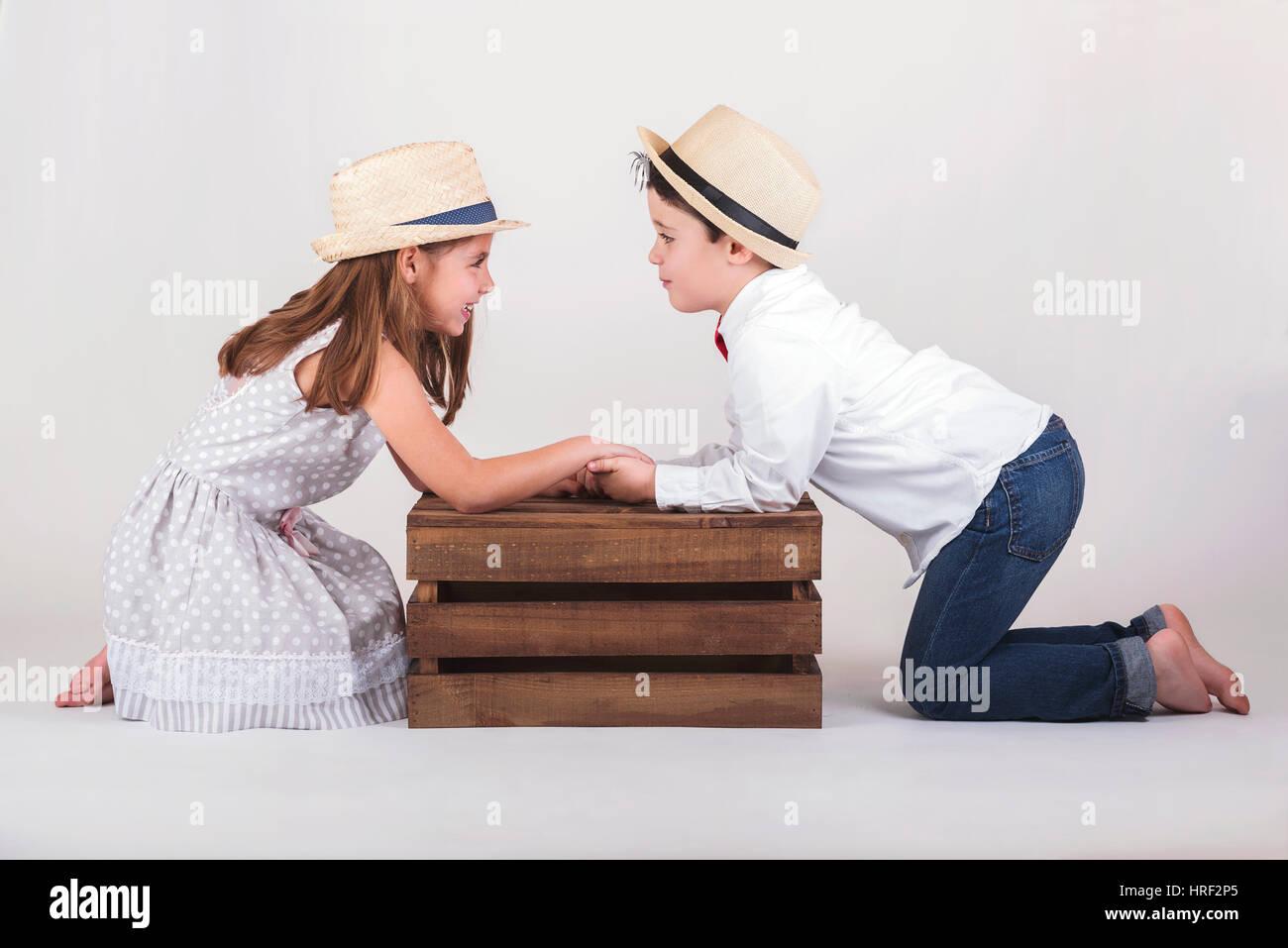 Little boyfriends. Gives a little boy Valentine's heart to girlfriend. - Stock Image