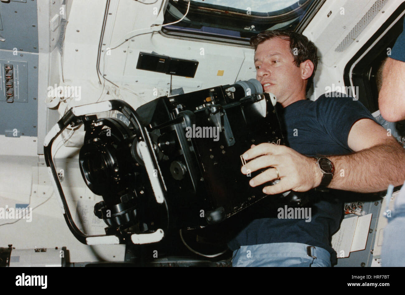 STS-41-C, Astronaut Hart with IMAX Camera, 1984 - Stock Image
