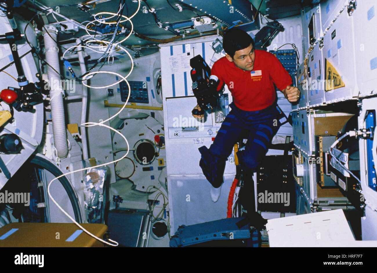 STS-41, Astronaut with Arriflex, 1990 - Stock Image