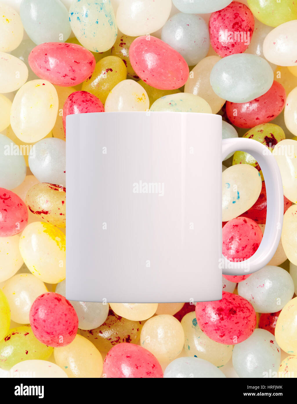 coffee mug mockup infant of a background of lots of jelly beans