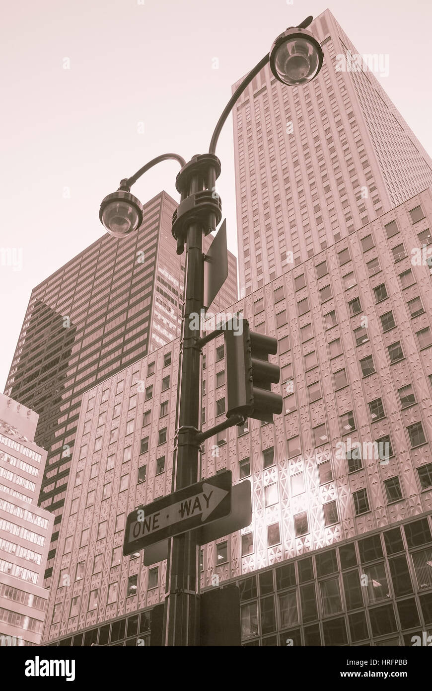 one-way traffic light with skyscrapers in New York City Stock Photo