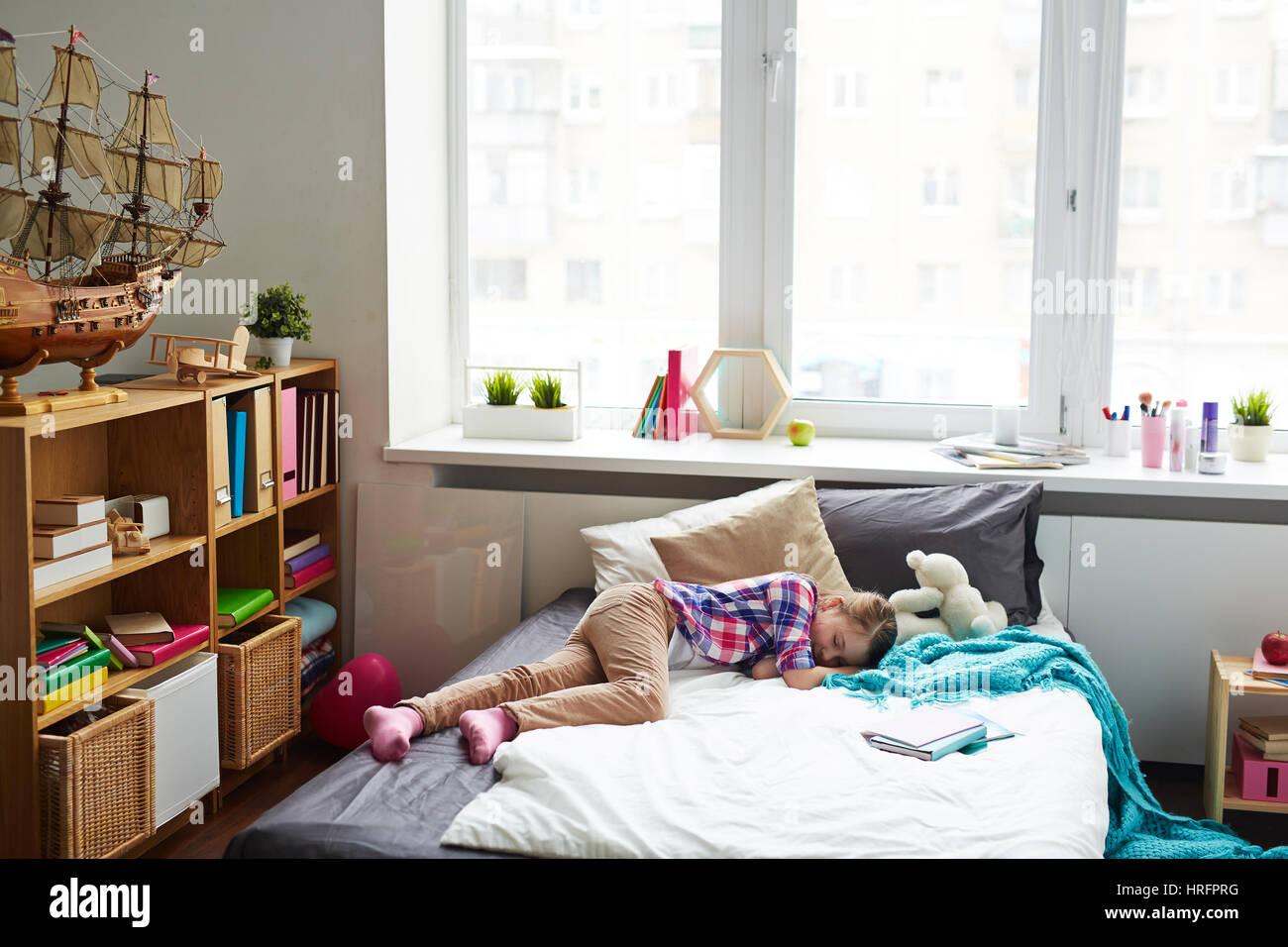Tired Schoolgirl Sleeping In Stylish Cozy Bedroom With Large Window Modern Furniture And Big Ship