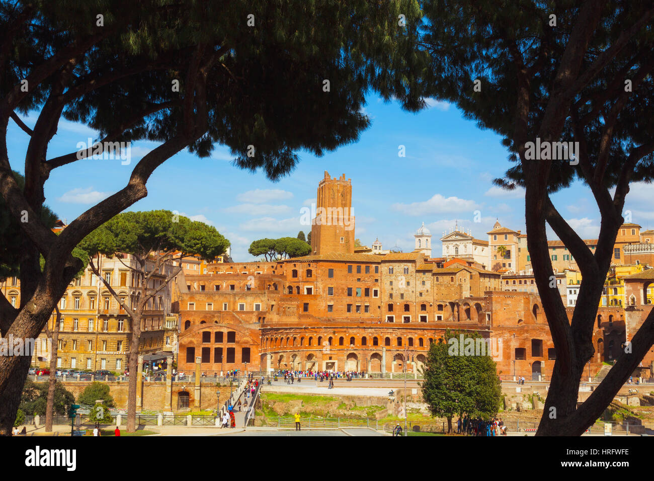 Rome, Italy. Trajan's Forum and market dating from the second century AD, at dusk. The tower, centre, is the - Stock Image