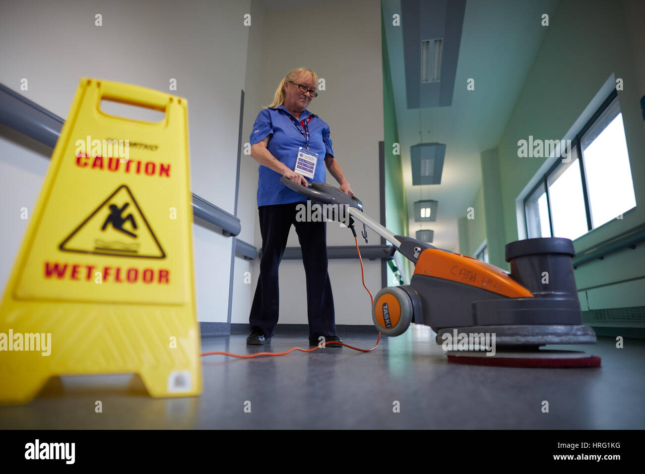 Sodexo cleaner, corridor, interior, working, pushing,Sodexo, Stoke-on-Trent. Stoke University Hospital, Interior, Great - Stock Image