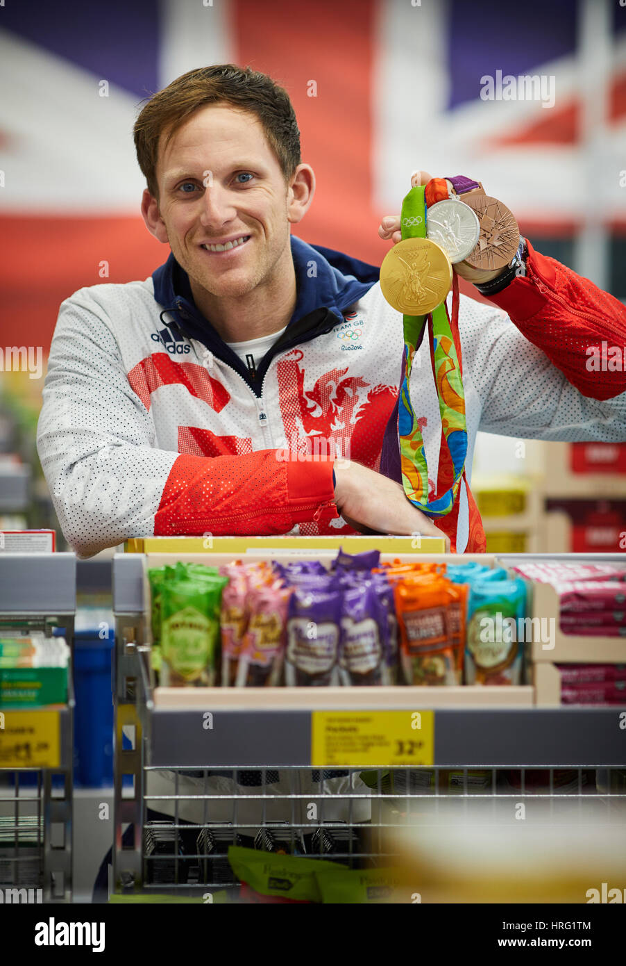 Matt Longridge with medals inside his local Aldi store in Northwich, Cheshire, England, UK. - Stock Image