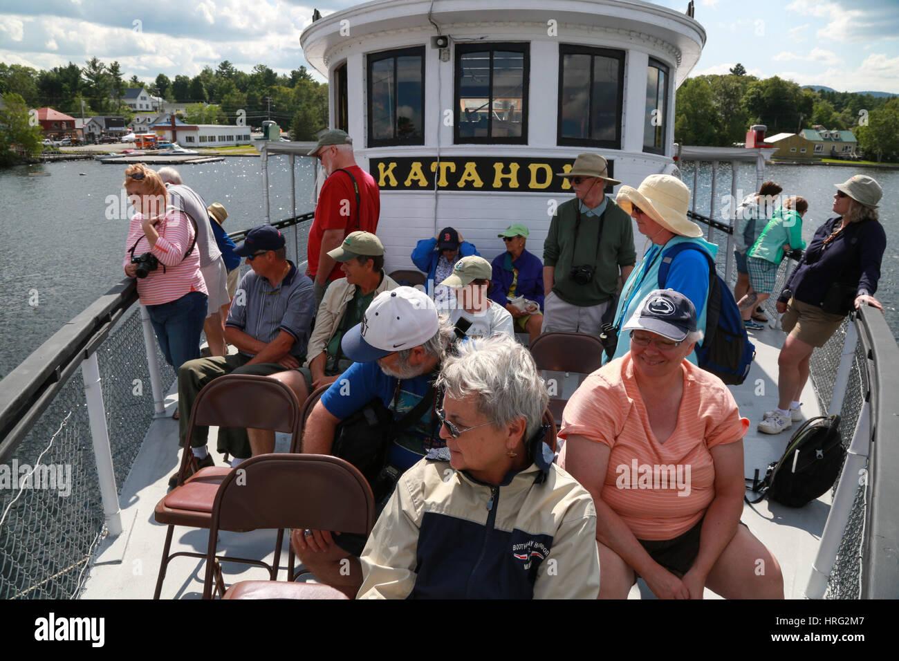 Day trip passengers taking a cruise on Moosehead Lake aboard the Century-old Motor Vessel Katahdin Stock Photo