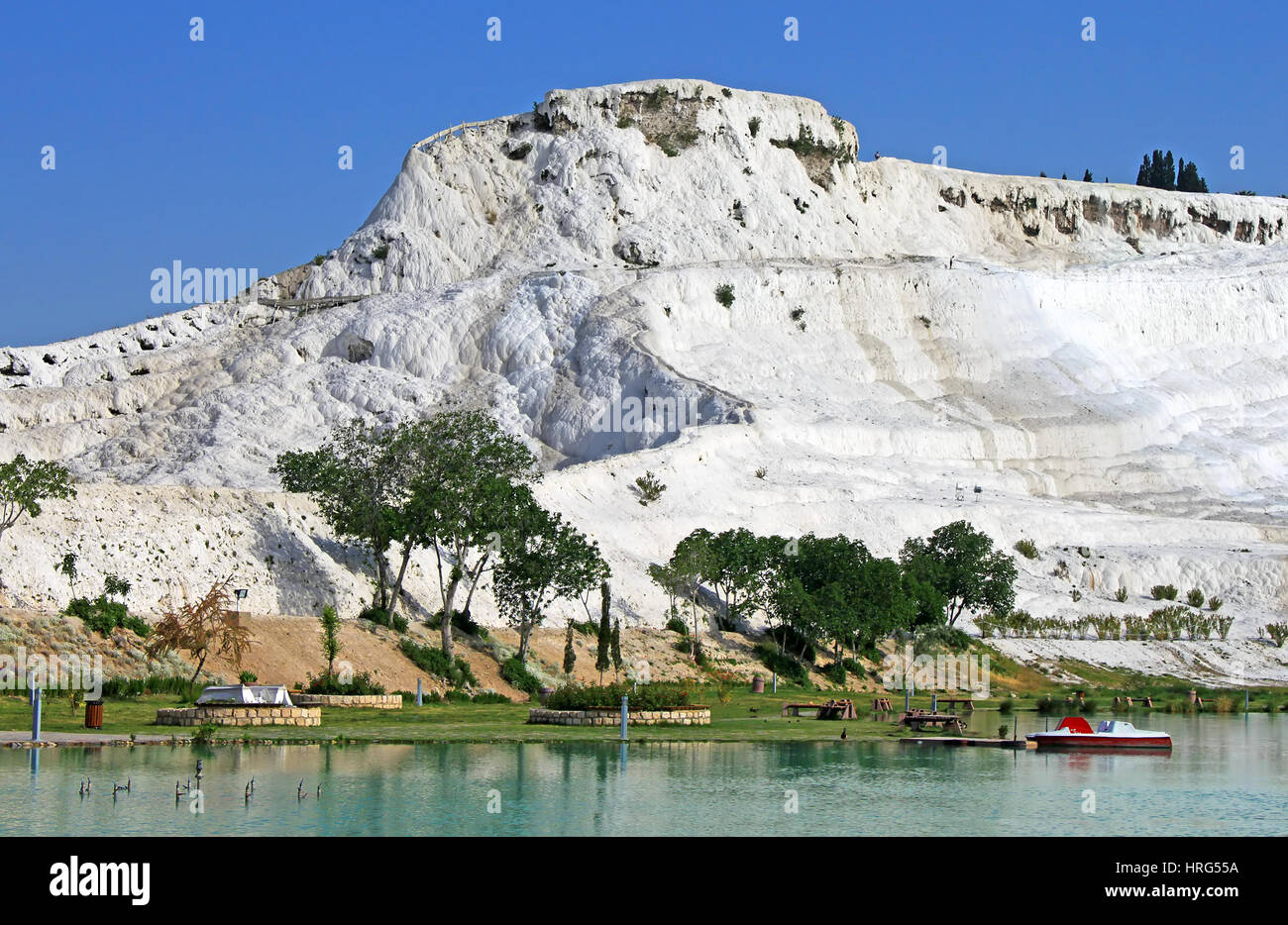 Lake and calcified limestone terraces on background, Pamukkale, Turkey - Stock Image