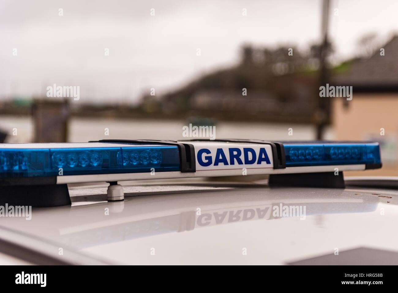Garda/Irish Police sign and blue lights on a Garda/Police car with copy space. Stock Photo
