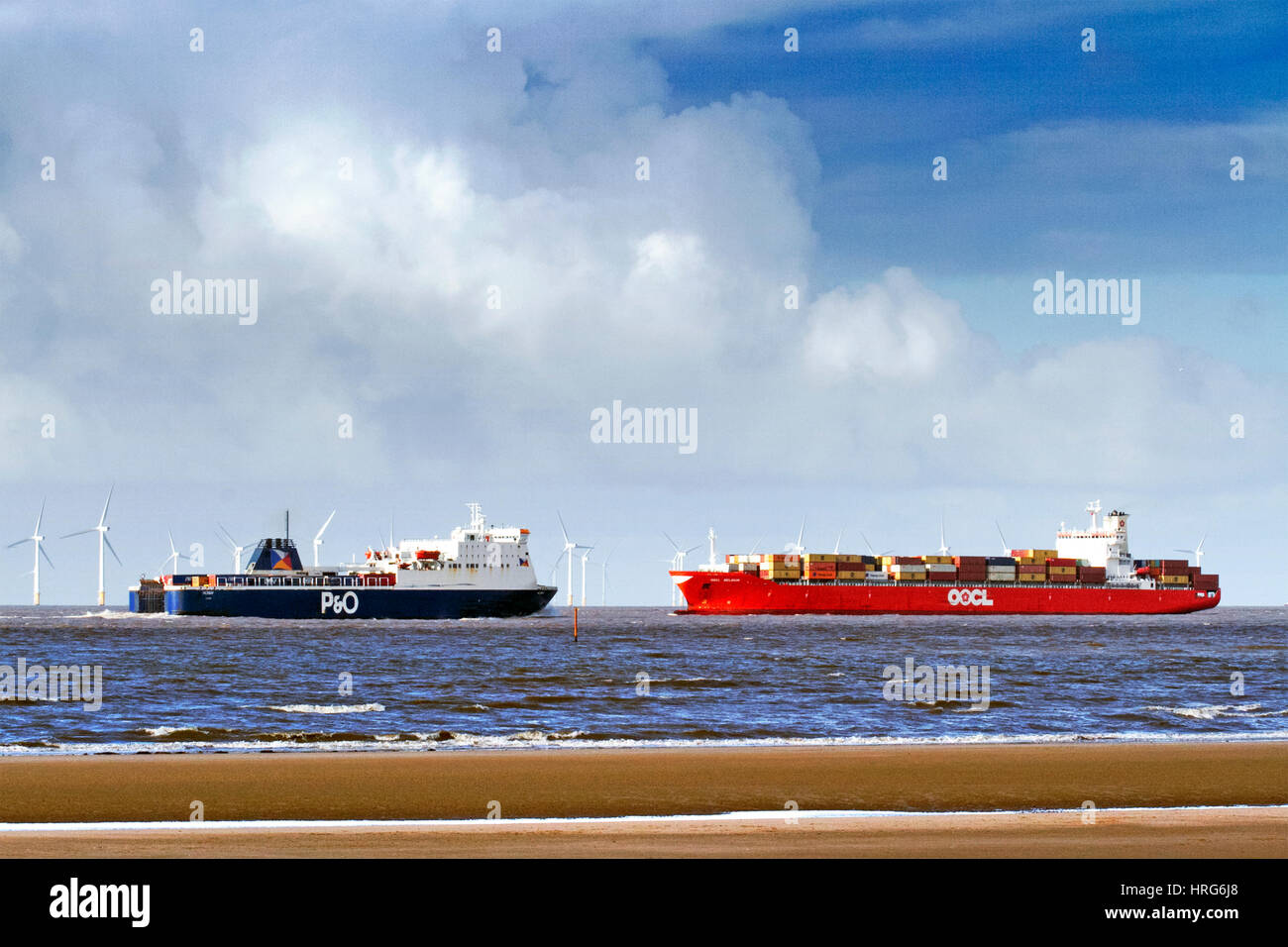 Freight Arrivals to Liverpool Freeport, Liverpool, Merseyside. March 1st 2017.  Two huge shipping vessels navigate - Stock Image