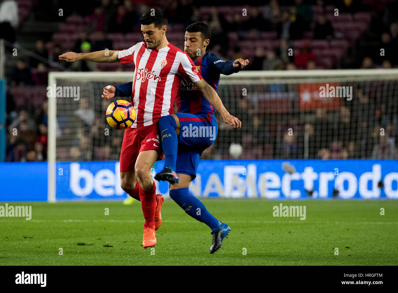 Camp Not Stadium, Barcelona, Spain. 1st March, 2017. Rafinha tries to stole the ball to Canella at Camp Nou Stadium, - Stock Image