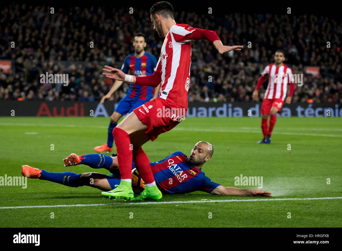 Camp Not Stadium, Barcelona, Spain. 1st March, 2017. Mascherano cuts the kick of Castro at the box at Camp Nou Stadium, - Stock Image