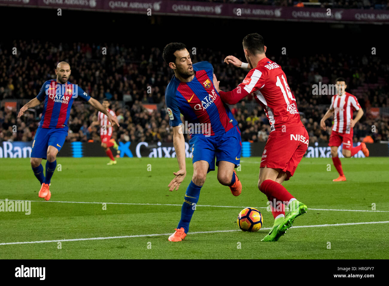 Camp Not Stadium, Barcelona, Spain. 1st March, 2017. Burgui escapes from Busquets at Camp Nou Stadium, Barcelona, - Stock Image