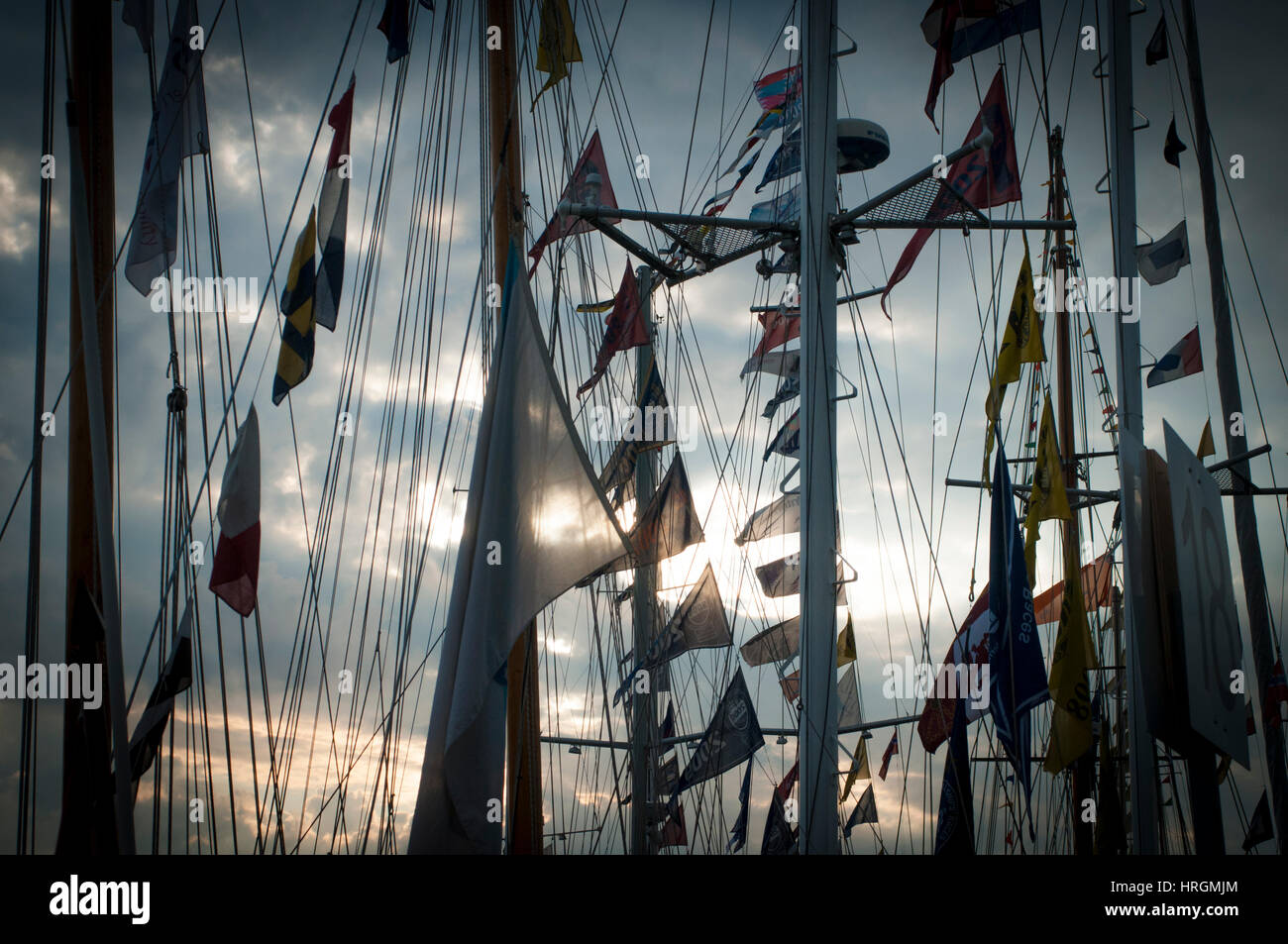 Ships flags at sunset. Tall ship races 2014 - Bergen, Norway. - Stock Image