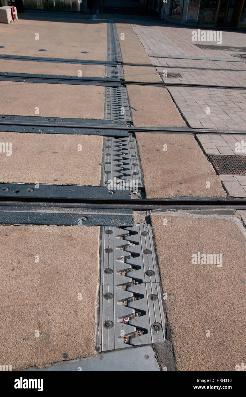 Metal joint in road allows for expansion and contraction on Bridge Pont Battant in Besancon France  Tram lines cross - Stock Image