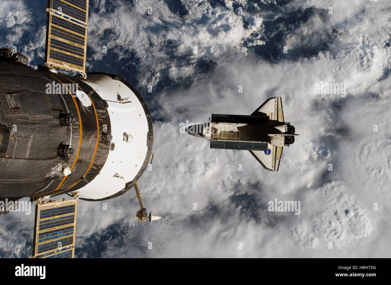 Space Shuttle Atlantis below ISS - Stock Image