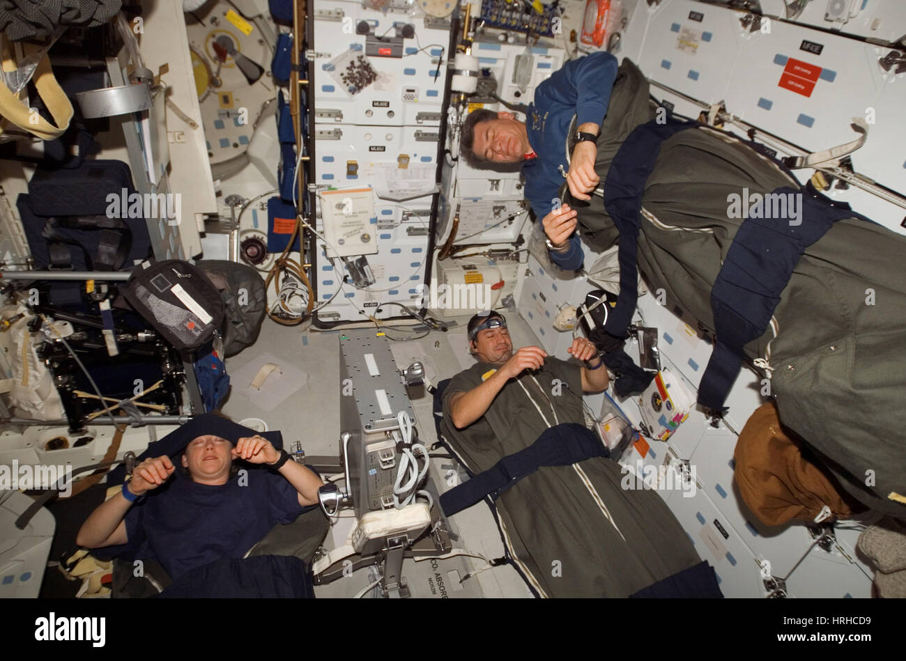 STS-120, Astronauts Sleeping, 2007 - Stock Image