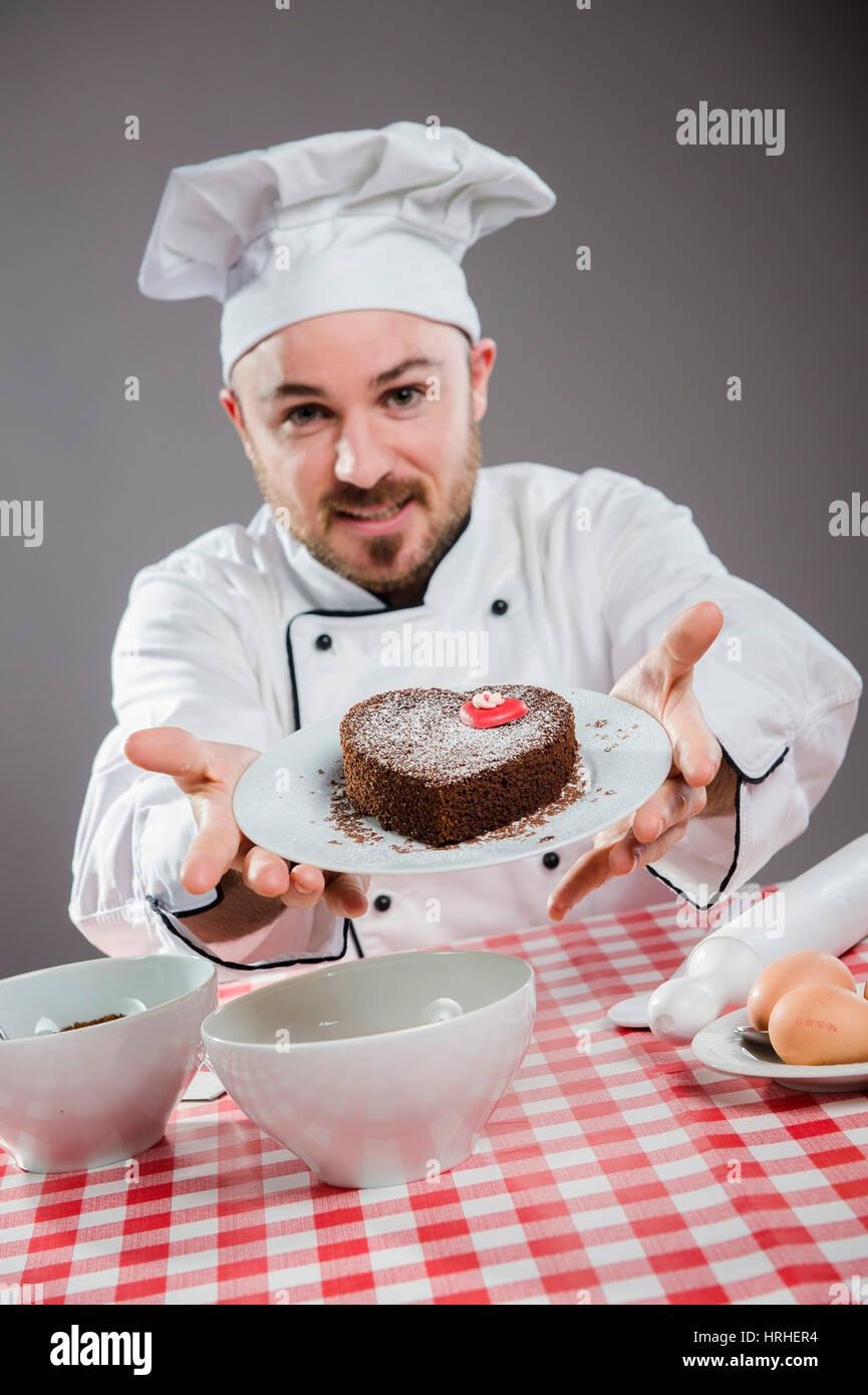 Kuchenbaecker - cake baker Stock Photo