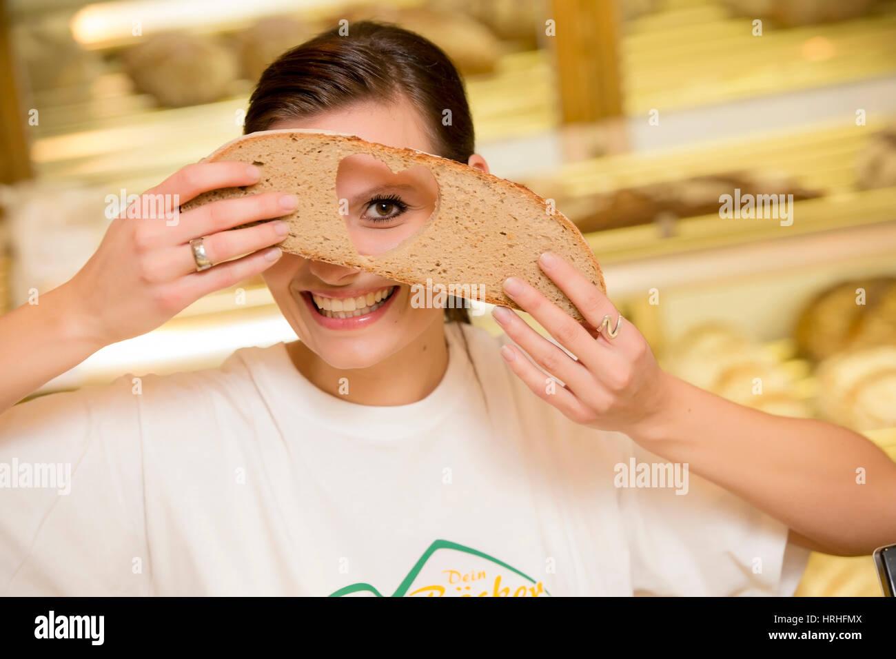 Angestellte in der Baeckerei - clerk in a bakery Stock Photo