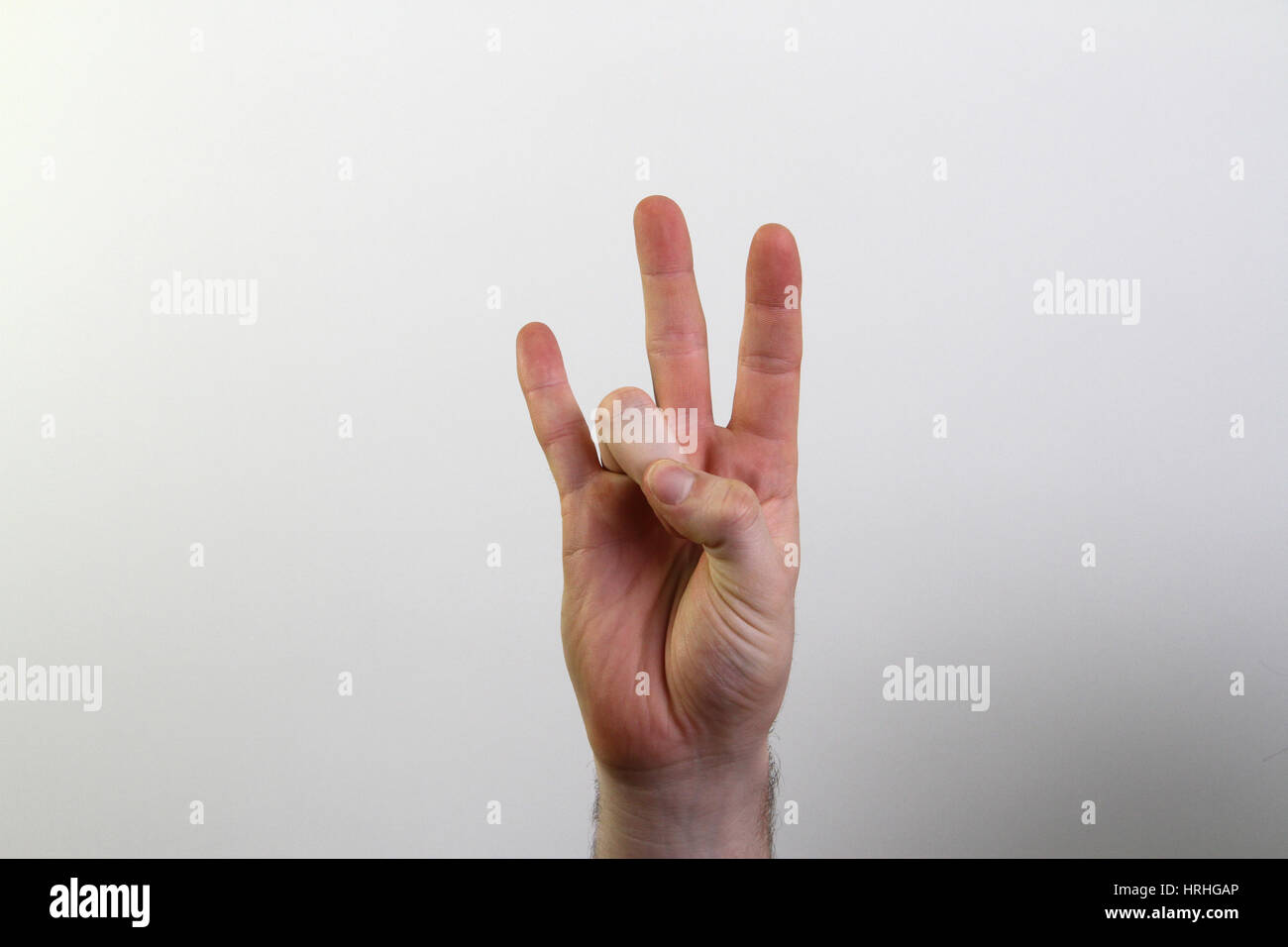 Hand signing number seven - Stock Image