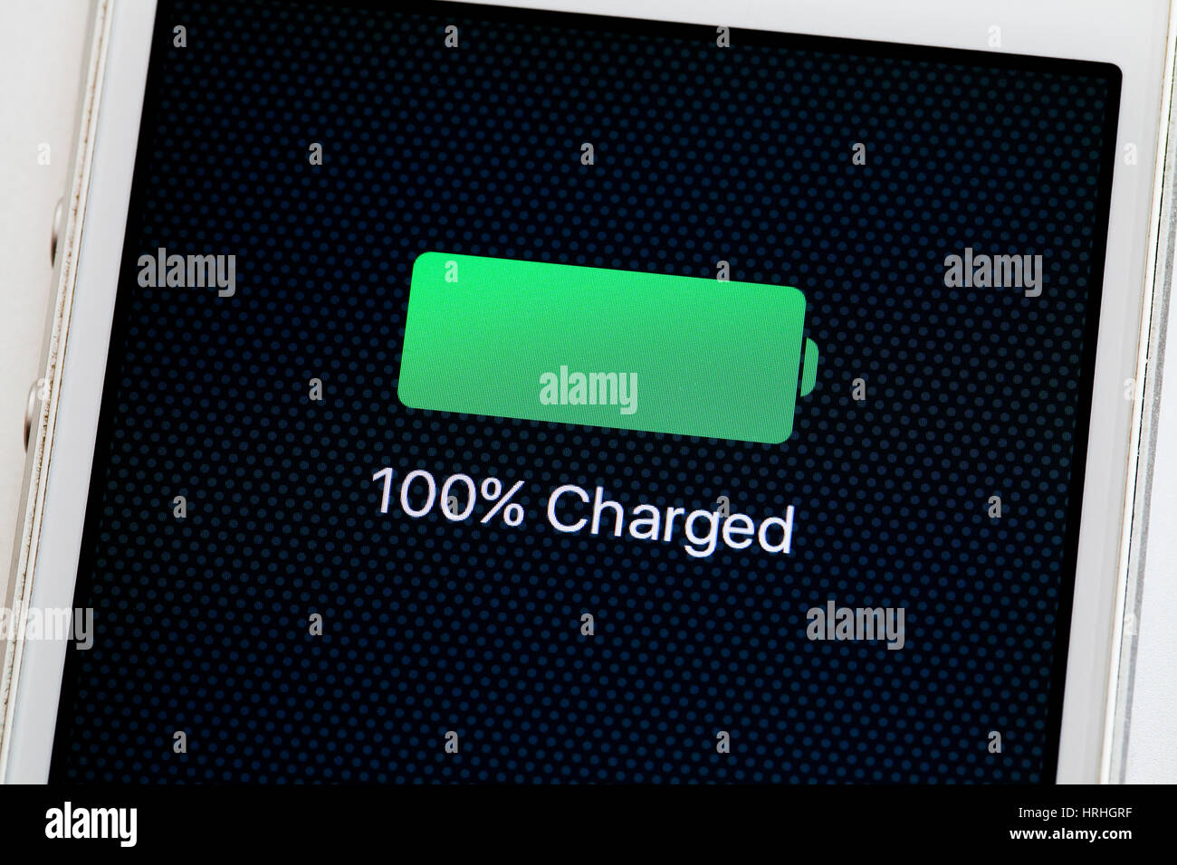 100% battery charge message on iPhone screen (full charg icon) -USA - Stock Image