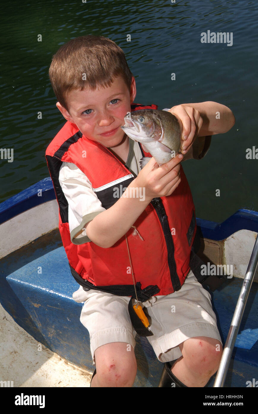 Boy Holding Fishing Line Stock Photos & Boy Holding Fishing Line ...