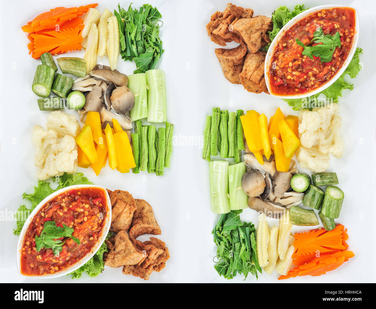Traditional Thai mix spicy sauce or Nam Prik in Thai name with mix vegetable Stock Photo