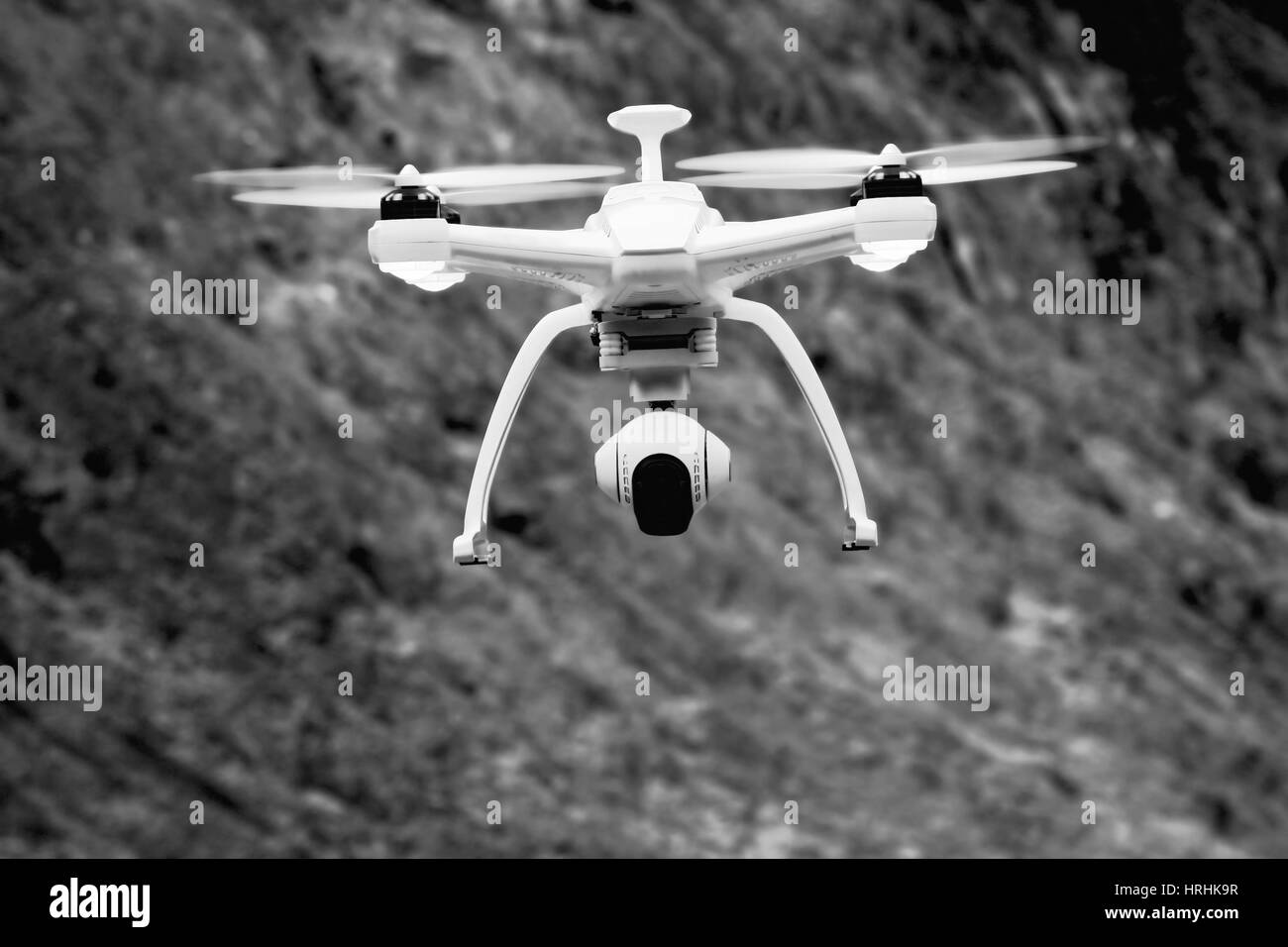 drone flying with  black and white background - Stock Image