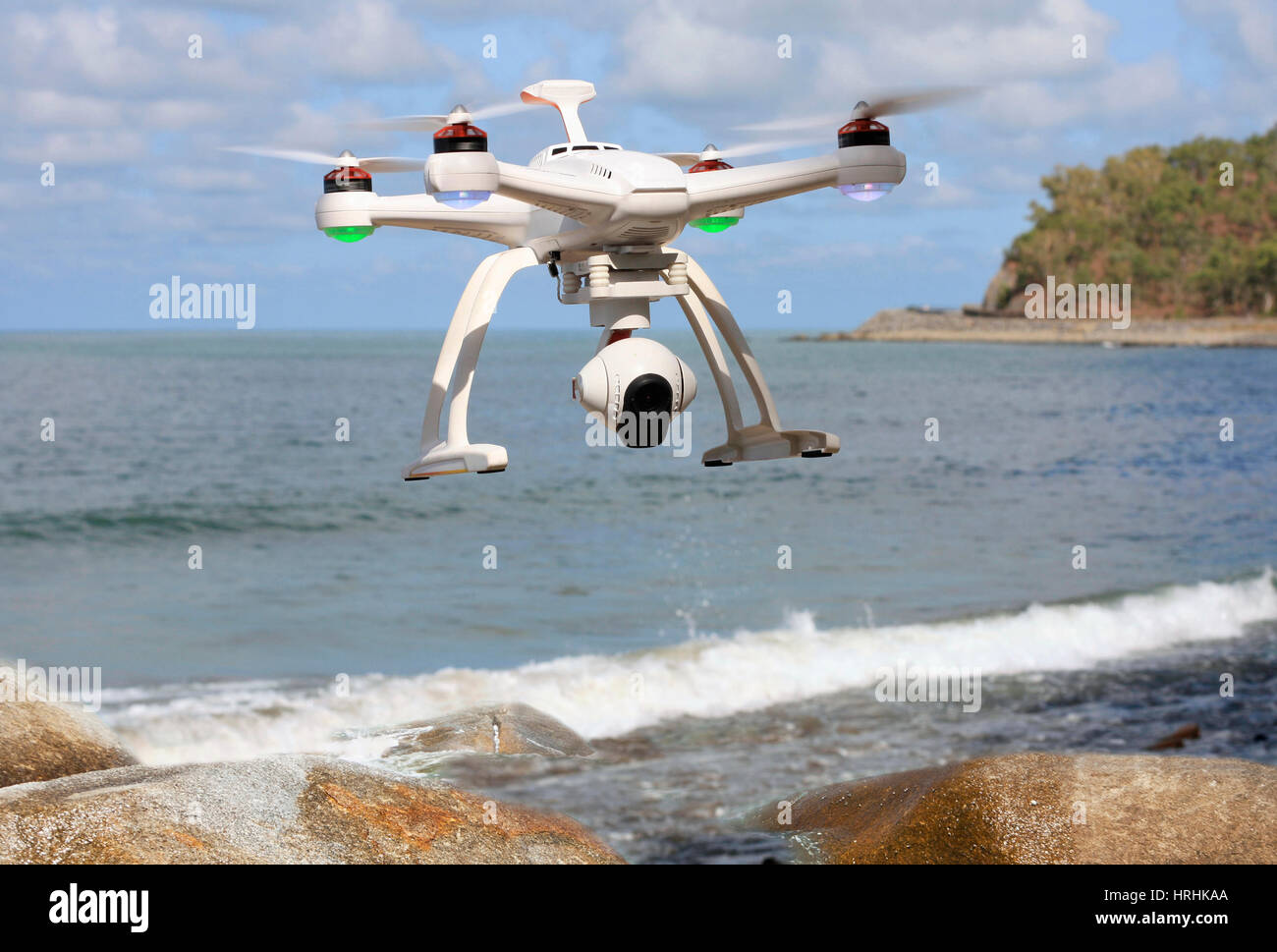 drone with camera flying over the sea - Stock Image